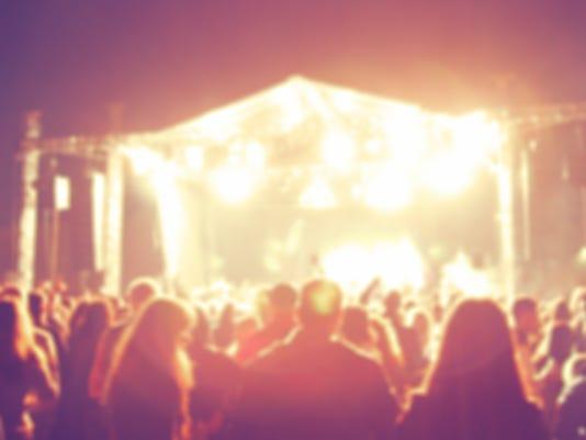 De-focused concert crowd.