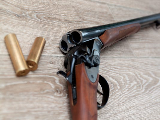double-barreled hunting rifle closeup on wooden