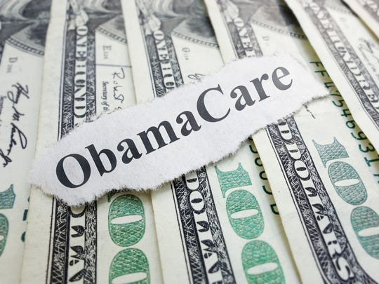 Obamacare newspaper headline on cash