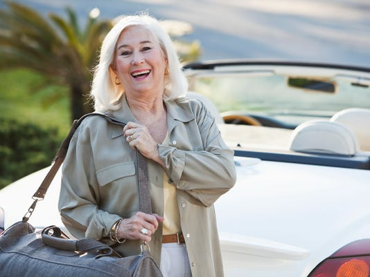 Senior woman with convertible