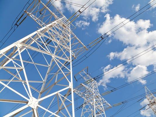 Power transmission lines against blue sky