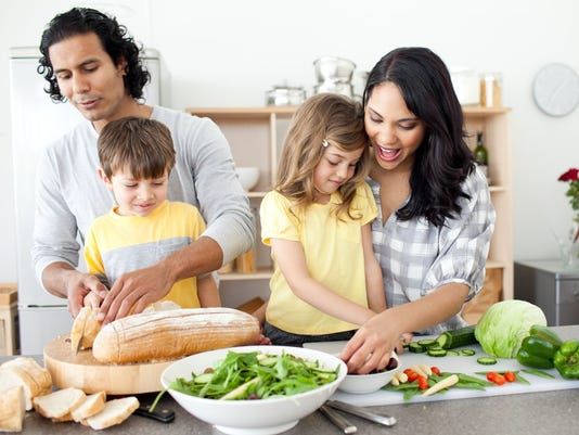Positive family preparing lunch