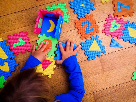 New Mexico's child welfare department is proposing to tighten income requirements for families to begin receiving child care assistance.