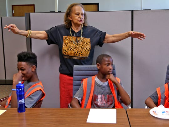 Flora Belle Bryant talks to teens with the Tarkington Teen Work Crew at the Martin Luther King Community Center, as they get ready to watch and discuss a movie about the Lost Boys of the Sudan, Tuesday, June 20, 2017.  During the program, the 33 boys between the ages of 13 and 17 clean up the neighborhood, but they also get connected with tutors, learn to understand and control their emotions, learn conflict resolution, and learn how to manage their money.  They may $8.25 an hour for 20 hours a week during the summer.  This class is exploring their emotional intelligence.