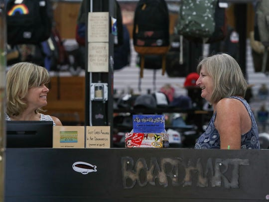 Boardmart co-owners Kellie Ercolano, left, and Denise