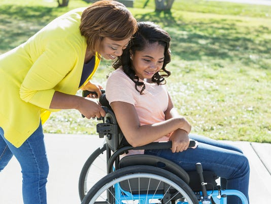 Mother with teenage daughter in wheelchair