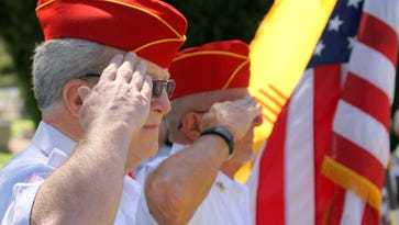 """""""Old Glory"""" flapped in the wind during Monday's Memorial Day ceremony at Mountain View Cemetery."""