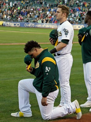 Sept. 23: Athletics catcher Bruce Maxwell kneels as