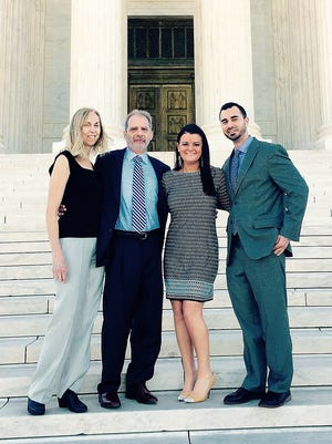 Elmira attorney Allan Charlap, second from left, stands in front of the U.S. Supreme Court building after a swearing-in ceremony. Joining him are his wife Barbara, left, his daughter-in-law Angela and his son Aaron Charlap.