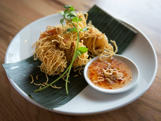 The new Buddha Barn in Sayler Park serves up Riding Long Tails as a starter. It's deep fried wrapped Prawns with angel hair noodle, served with caramelized shallot in chili plum sauce. The new Thai restaurant opened a couple months ago and is owned by chef Niruti Puakkawe, who goes by  Jack.