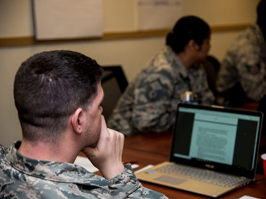 An Enlisted Professional Military Education Instructors Course student listens as his instructor reviews one of their previous lessons, April 24, 2018, Maxwell Air Force Base.