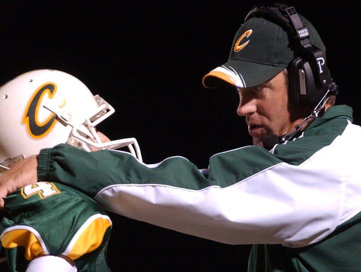 Calvary Baptist head coach Doug Pederson talks with