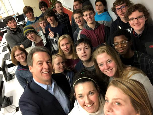 "Gov. Steve Bullock takes ""selfie"" with Helena High School students in early 2018 after announcing internet neutrality policy."