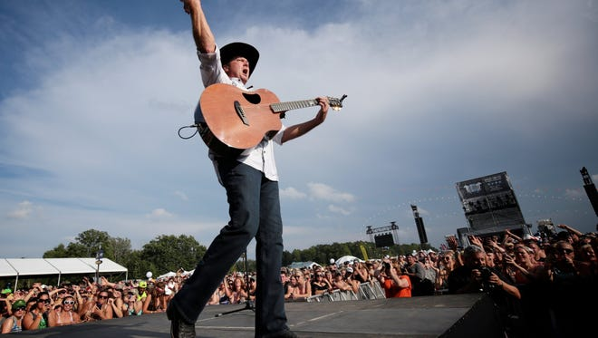 Tracy Lawrence performs to the crowd during the Faster Horses Festival on Friday, July 17, 2015, at the Michigan International Speedway in Brooklyn, Mich.