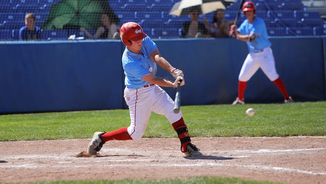 Bennett Laurence of D-BAT Bonesio makes contact at the plate against Frozen Ropes-Florence during Monday's CMWS championship bracket game at Ricketts Park.