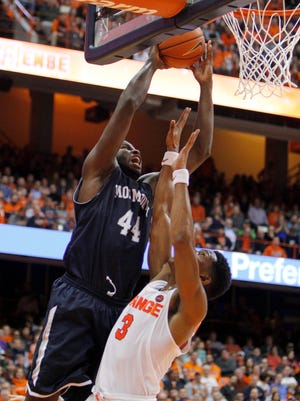 Monmouth's Sam Ibiezugbe, left, shoots against Syracuse's Andrew White III duringp the first half of an NCAA college basketball game in Syracuse, N.Y., Friday, Nov. 18, 2016. (AP Photo/Nick Lisi)
