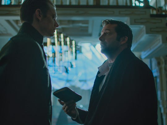 Joel Kinnaman and James Purefoy discuss a deal in 'Altered