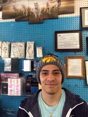 Jerry Moncada works behind the counter of his family's