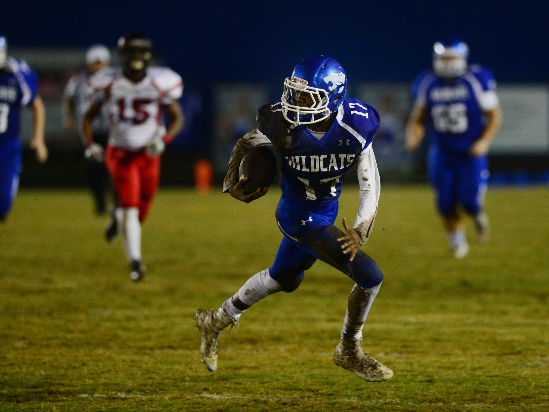 Woodmont High Keyshun Kilgore (17) attempts to run past Hillcrest defense at Whitt Memorial Field on Friday.