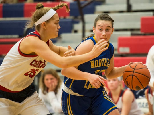 Northern Lebanon's Zoe Zerman drives to the hoop against New Oxford's Lauren Slonaker as Northern Lebanon defeated New Oxford 53-38 to win the Lebanon girls basketball holiday tournament on Wednesday, Dec. 28, 2016.