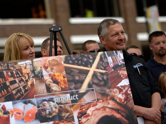 In this 2014 photo, John Pagel, of Pagel's Ponderosa Dairy, and members of his family during Thursday's press conference about the new public market retail concept that is coming to the historic Broadway District in downtown Green Bay.