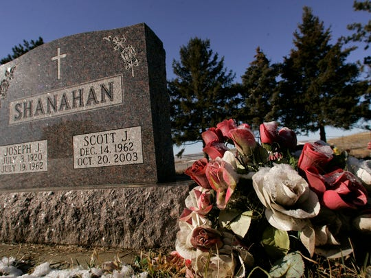Scott Shanahan's grave can be seen in the cemetery behind St. Peter's Catholic Church in Defiance, Iowa, in this Des Moines Register file photo.