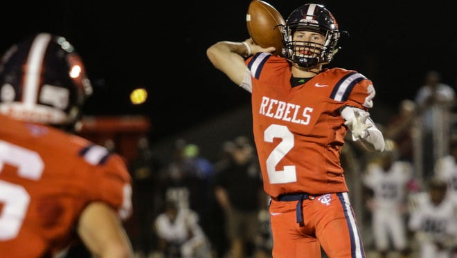 Teurlings Rebels quarterback Hayden Cantrelle throws a pass during the first quarter of their game with Carencro on Friday night.