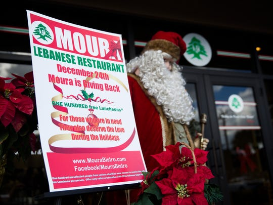 Moura's Bistro in North Naples gave away 100 free lunches to participants in different charities around Naples such as St. Matthews House and Justin's Place on Saturday, December 24, 2016.