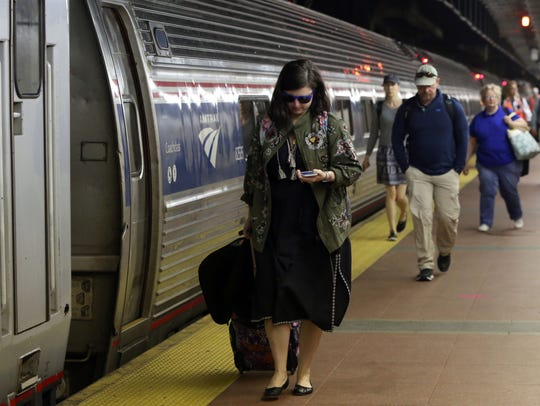 Commuters aboard the 7:30 a.m. Amtrak train from Albany