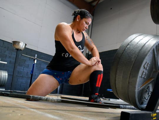 Perez is using her passion for powerlifting as a way