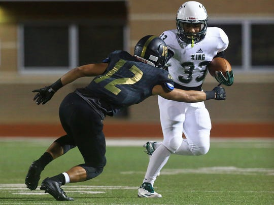 GABE HERNANDEZ/CALLER-TIMESKing's Bryson Butler runs past Edcouch-Elsa's James Rodriguez during the 5A area round game Friday, Nov. 18, 2016, at Shirley Field in Laredo.