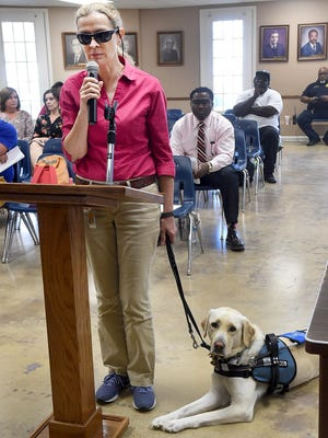 Agnes Courville appears before the Opelousas Board of Aldermen recently with her sight dog. Courville presented an issue to the board which outlined her problems of walking with her dog amid several attacks from pit bulls which she said attacked her and her animal near her home in the Opelousas historic district.