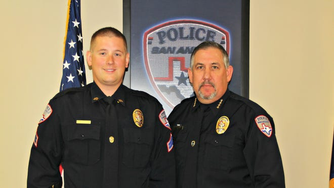 Sgt. John Bouligny, left, stands with San Angelo Police Chief Frank Carter after his promotion April 25.