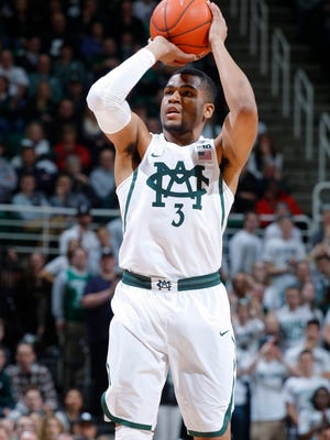 Michigan State's Alvin Ellis III shoots a 3-pointer against Ohio State during the first half of an NCAA college basketball game, Tuesday, Feb. 14, 2017, in East Lansing, Mich. (AP Photo/Al Goldis)