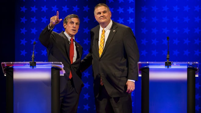 Rep. John Carney (left) and state Sen. Colin Bonini stand together before the start of the Delaware governor's debate at Mitchell Hall on the campus of the University of Delaware in Newark on Wednesday night.