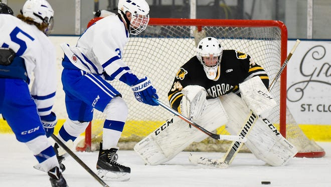 Sartell's William McCabe takes a shot of Warroad goalie Parker Orchard during the second period Saturday, Dec. 3, at the Bernicks Arena in Sartell.