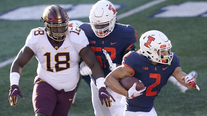Illinois running back Chase Brown carries the ball on Saturday, Nov. 7, in Champaign.