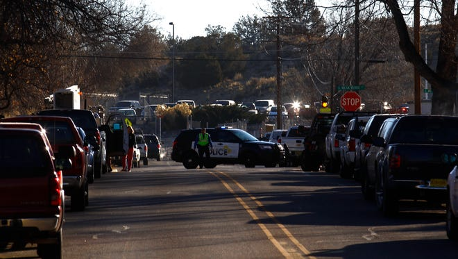 Police block the entrance to Aztec High School on Thursday after a fatal shooting on campus.