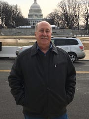 Dennis Palmer, a Gloucester Township resident and early supporter of President-elect Donald Trump, stands outside the U.S. Capitol Building in Washington, D.C.