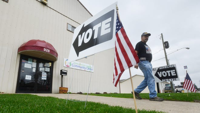 A voter leaves the Zanesville Civic League Civic Center in Zanesville on Tuesday.