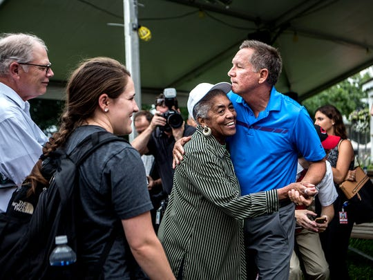 Gov. John Kasich dances with Laura Harvey at the Ohio State Fair during his tour of the grounds Thursday morning.