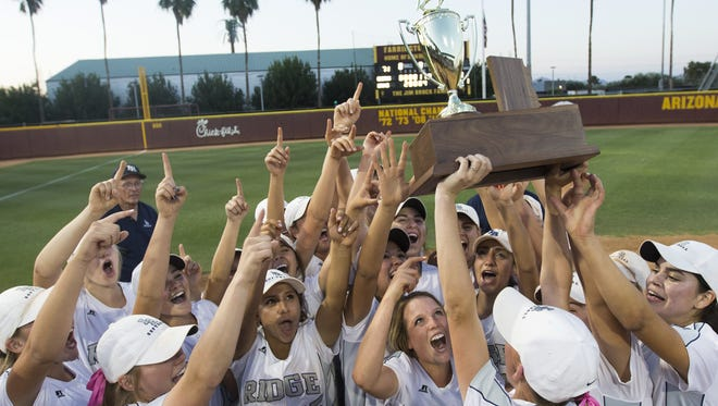 Ironwood Ridge's Mandy Lorenson (4) lifts the Division II State Championship trophy with her teammates after winning against Cactus at Farrington Stadium on May 16, 2016 in Tempe, Ariz.