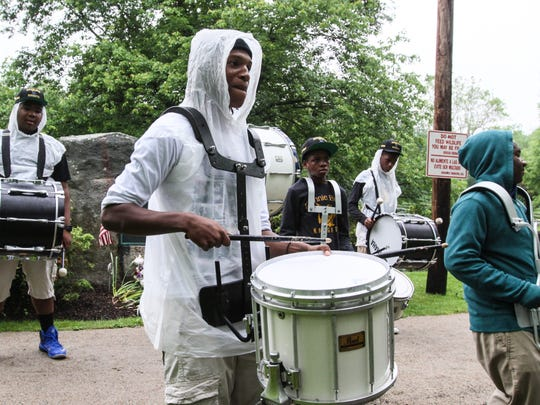 A drum squad continued to entertain participants even in the rain at Miles for Matheny event Sunday. The annual fundraiser was cut short due to inclement weather.
