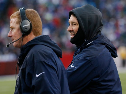 Dallas Cowboys head coach Jason Garrett, left, and quarterback Tony Romo look on from the sideline during the second half of an NFL football game against the Buffalo Bills, Sunday, Dec. 27, 2015, in Orchard Park, N.Y. (AP Photo/Bill Wippert)