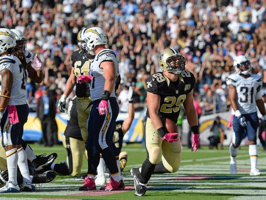 New Orleans Saints defensive back Tony Carter (29) reacts after scoring a touchdown during the fourth quarter against the San Diego Chargers at Qualcomm Stadium.