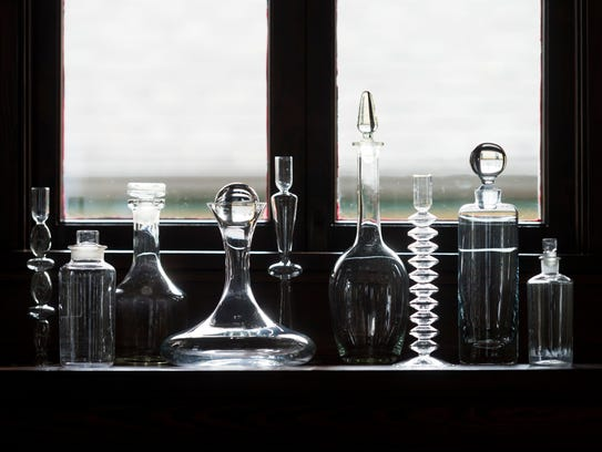 A collection of varied glass pieces sits on top of