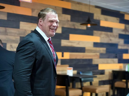 Glenn Jacobs works the room during his election watch