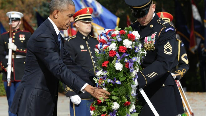Then-President Barack Obama laying a wreath at the Tomb of the Unknown Soldier at Arlington National Cemetery during a previous Veterans Day ceremony.