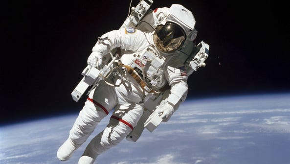 Astronaut Bruce McCandless flies a few yards from the