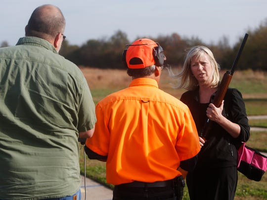 State Attorney General candidate Teresa Hensley talks with a member of the Missouri Department of Conservation at the Andy Dalton Shooting Range before trap shooting on Wednesday, November 2, 2016.